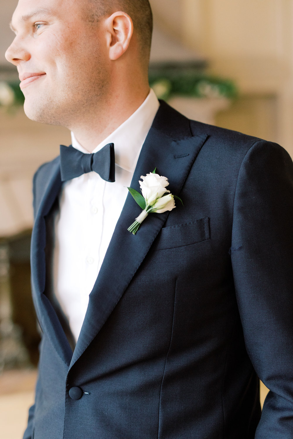 We loved this groom's clean and classic look in black with a simple white boutonniere for this romantic and classic wedding day for their french inspired green and white Cairnwood Estate wedding