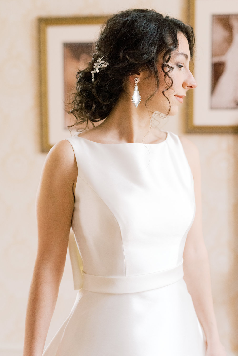 We loved how this bride's soft loose curls paired with her modern structured white wedding gown for her romantic and classic wedding day for their french inspired green and white Cairnwood Estate wedding