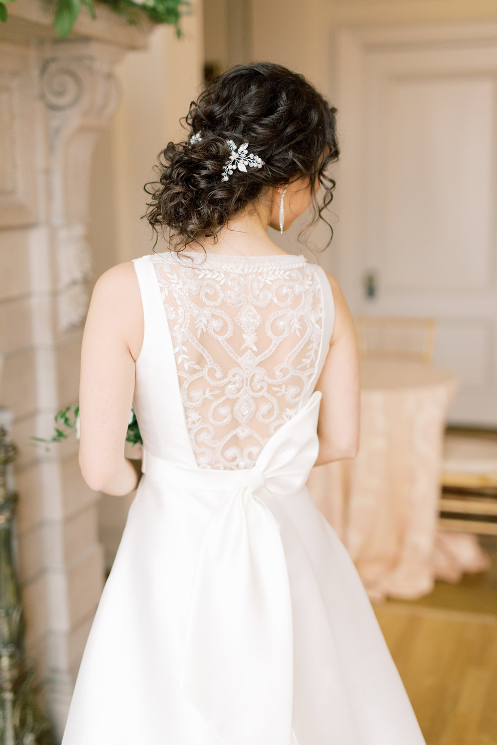 The lace back and modern asymmetrical bow on this wedding gown were flawless from this romantic and classic wedding day for their french inspired green and white Cairnwood Estate wedding