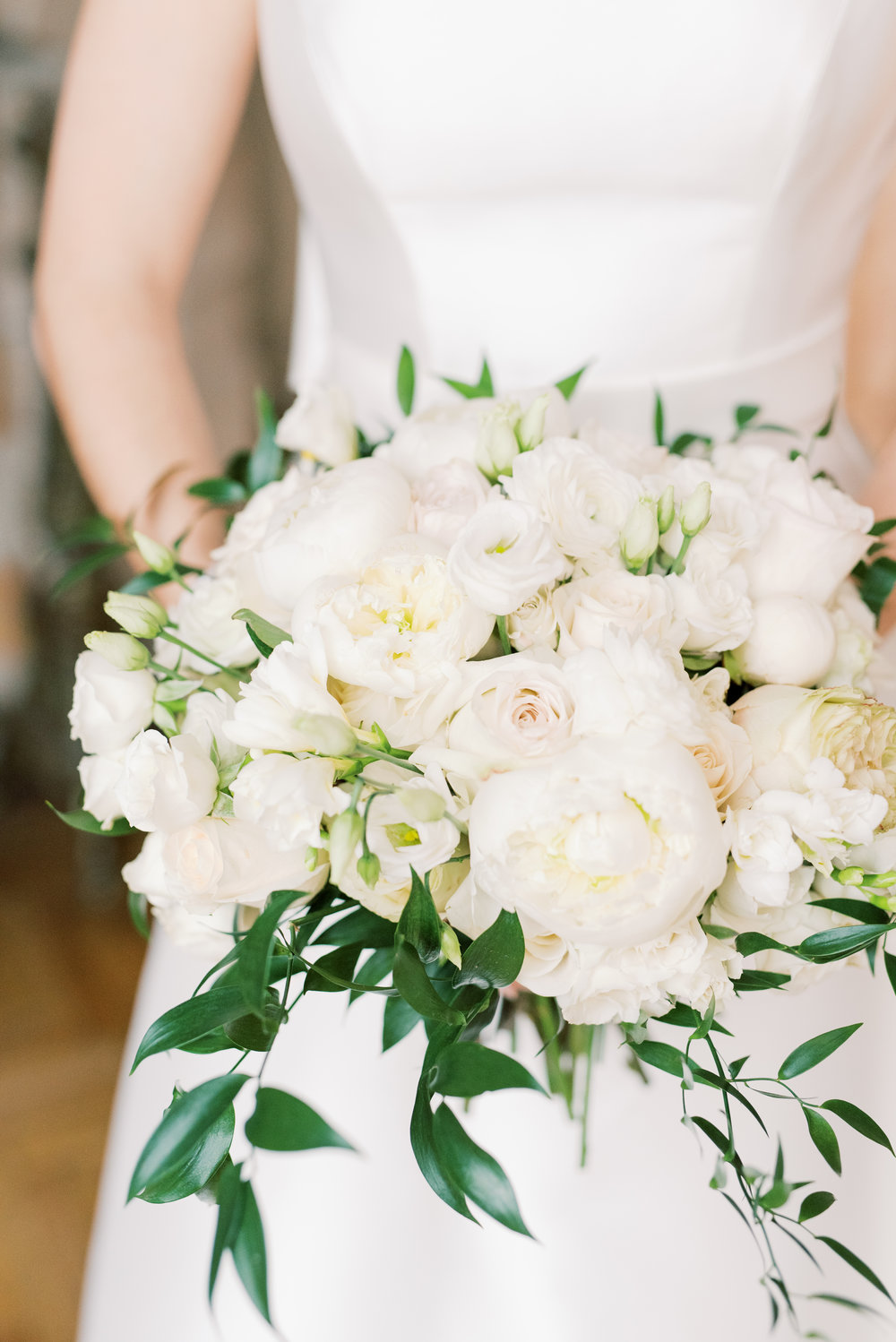 We loved this classic white bouquet with trailing greens from this romantic and classic wedding day for their french inspired green and white Cairnwood Estate wedding
