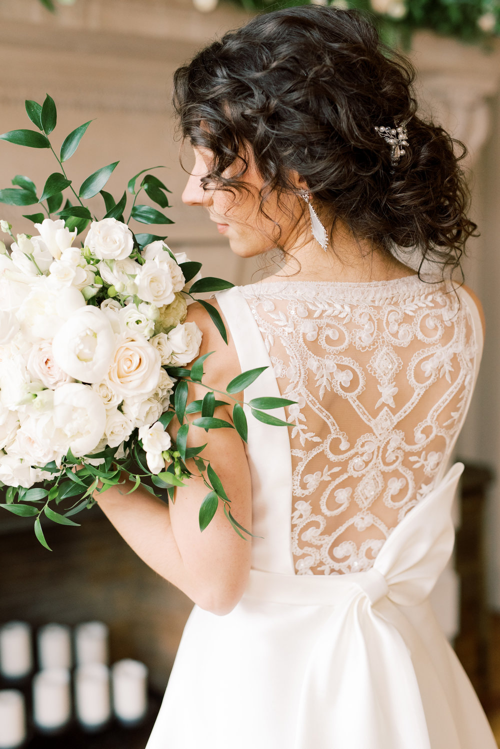 This bride's soft curls and the trailing greens of her bouquet add a romantic touch to this romantic and classic wedding day for their french inspired green and white Cairnwood Estate wedding