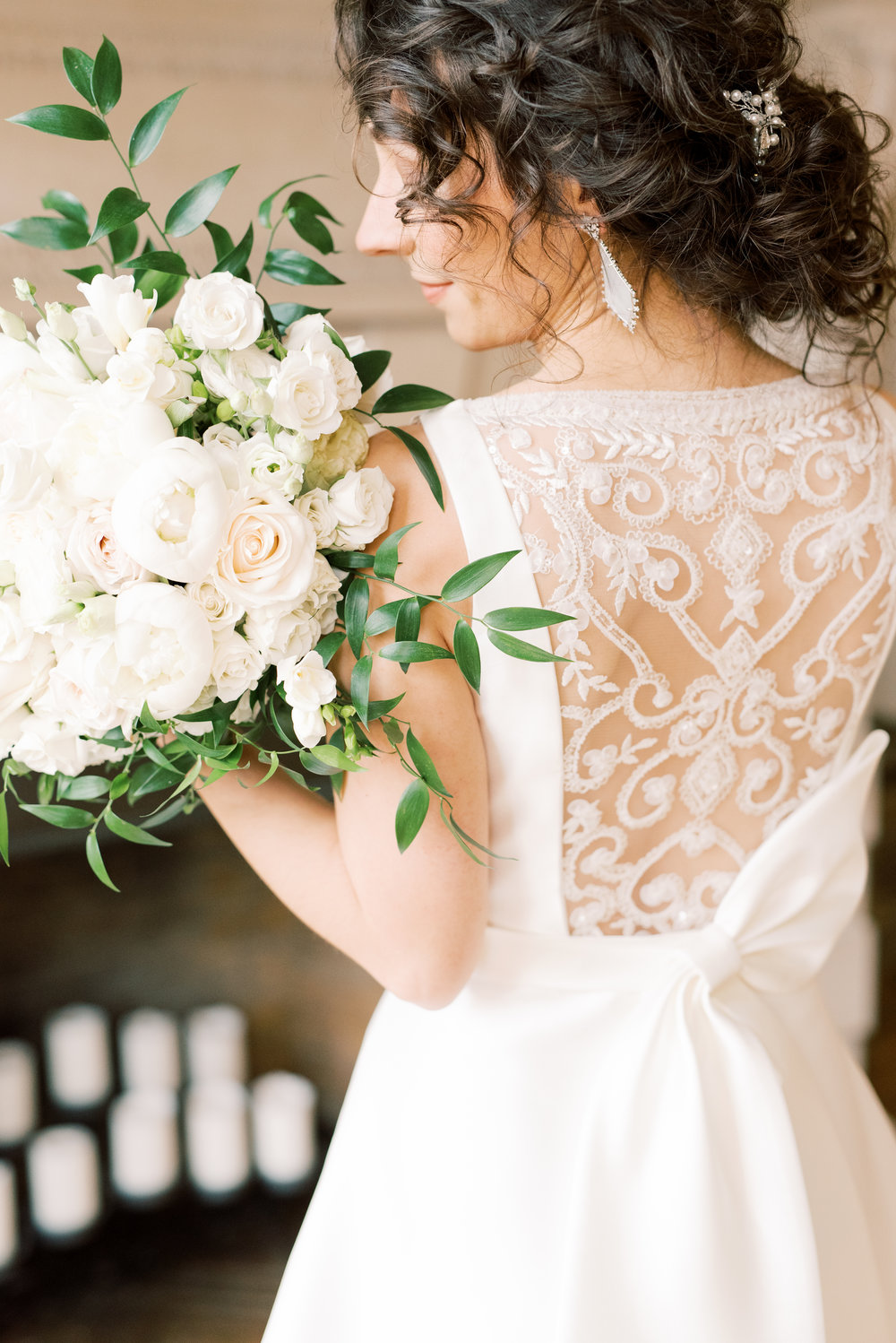 These classic white blooms paired with the modern lace back of this wedding dress were perfect for Angjela and Kevin's romantic and classic wedding day for their french inspired green and white Cairnwood Estate wedding.