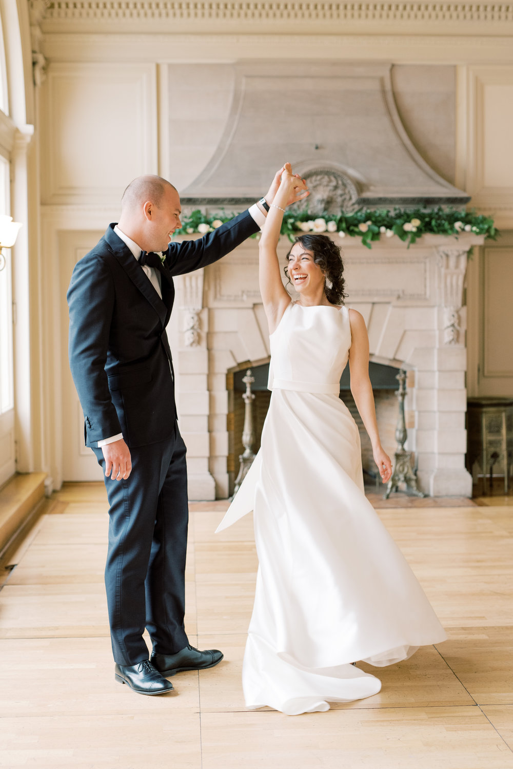 The big smile on our bride as her groom gives her a twirl says it all at this romantic and classic wedding day for their french inspired green and white Cairnwood Estate wedding