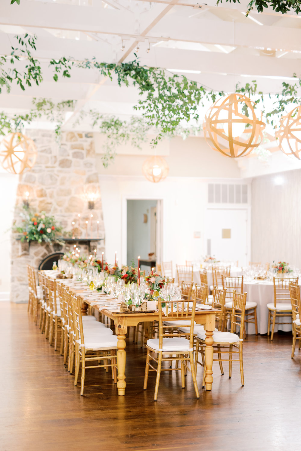 Romantic candle-lit table setting from modern autumn wedding at Pomme, Radnor PA. Pomme wedding photographer.