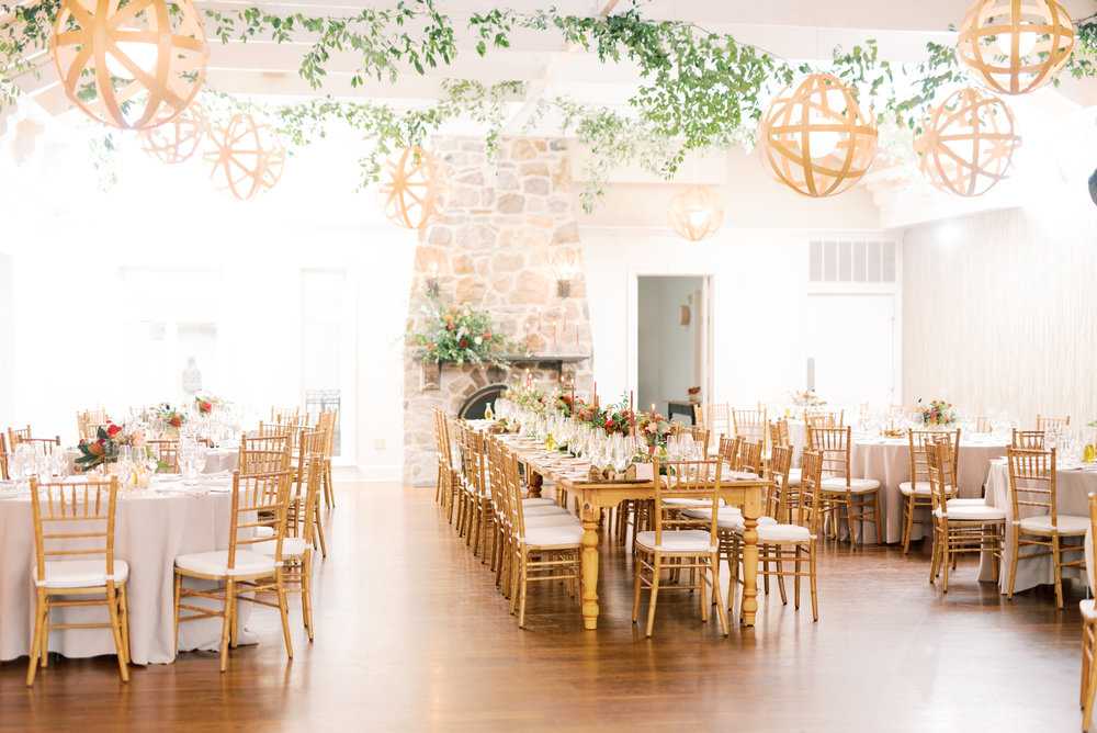 Romantic candle-lit tablescape at modern autumn wedding at Pomme, Radnor PA. Pomme wedding photographer.