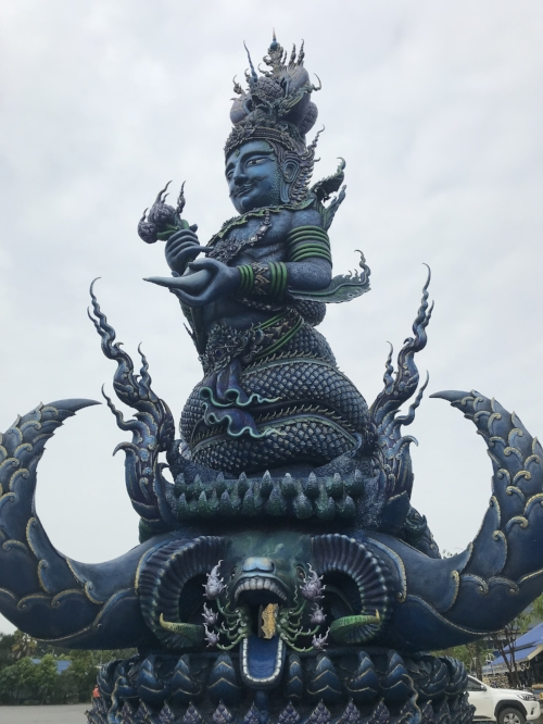 Wat Rong Sear Tean is a modern Buddhist temple in Chiang Rai, distinguished by its vivid blue coloring & elaborate carvings.