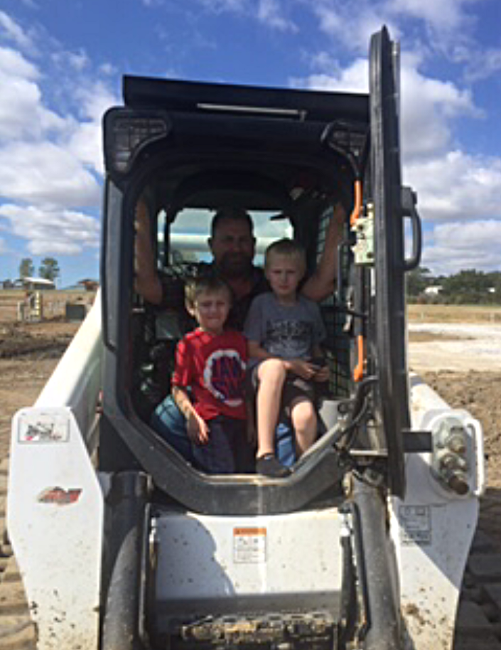 Owner, Jack Olson along with his two helpers Paxton & Ashton