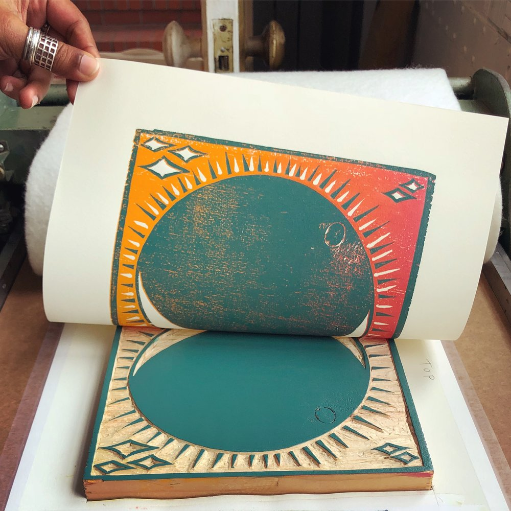 """Printing """"The Bloody Blue Moon"""" woodcut reduction by Ria Rajan and Nathalie Roland."""