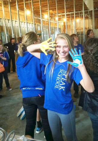When The Peak School moved into the old Summit Daily building, students lent a hand (literally) to help build the new school.