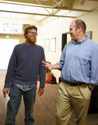 Head of School Travis Aldrich speaks with part-time Math teacher Ben Butler in the hallway between classes at The Peak School (Hugh Carey/Summit Daily).