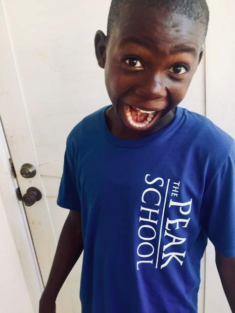 On Stephan's last trip to Haiti, he brought Jonas a t-shirt from The Peak School in Frisco.