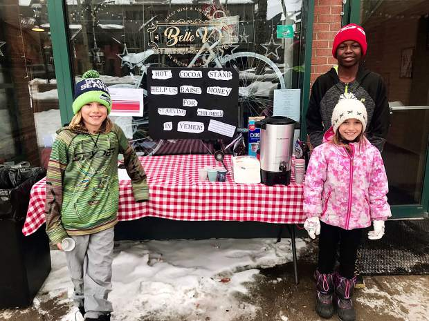 Jonas, Maxem and Eleeana at their hot cocoa stand in front of the Belle V Bistro in Breckenridge. The three raised $315 dollars for the International Rescue Committee over two days to help feed starving children in Yemen.