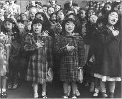 Dorothea Lange photograph of Japanese-American children reciting the pledge of allegiance.