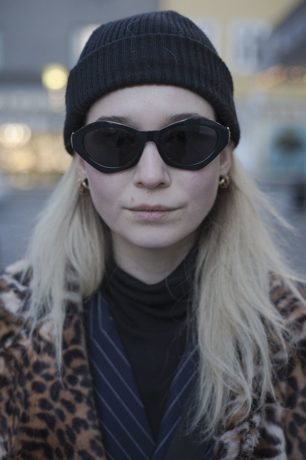 On the streets of Reykjavik. Stylish layering with Versace sunglasses.