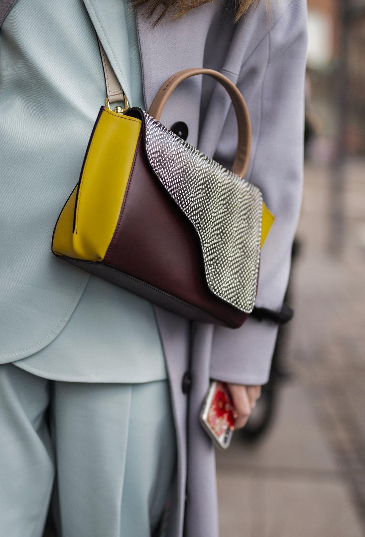 Alberte Whitta whith her detail handbag on the streets of Copenhagen during Fashion Week Streetstyle