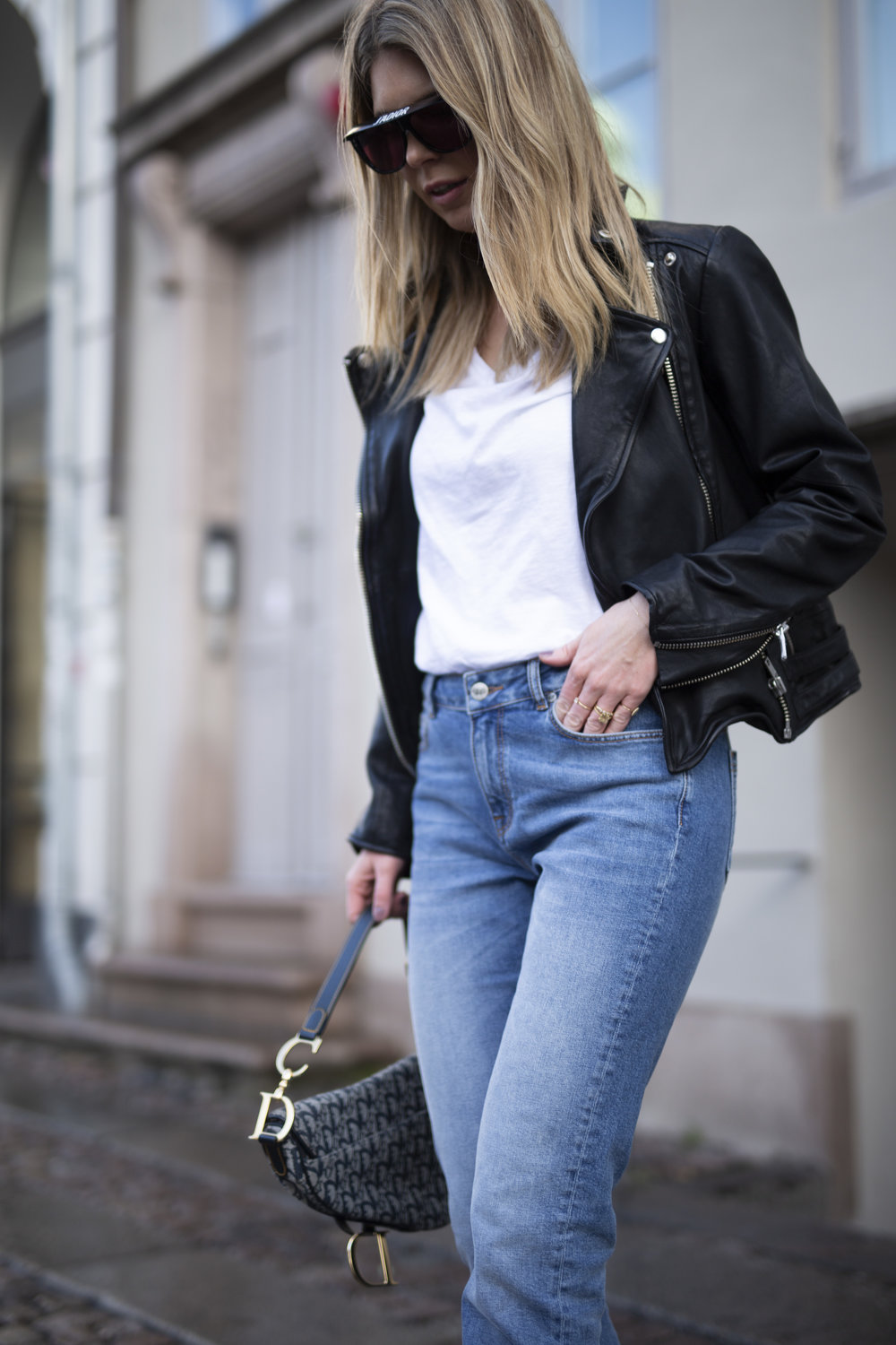 Cathrine Marie on the streets of Copenhagen wearing Denim Hunter jeans and white T-shirt