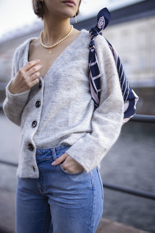 Julie Blichfeld on the streets of Copenhagen wearing Denim Hunter classical blue pants and a sweater
