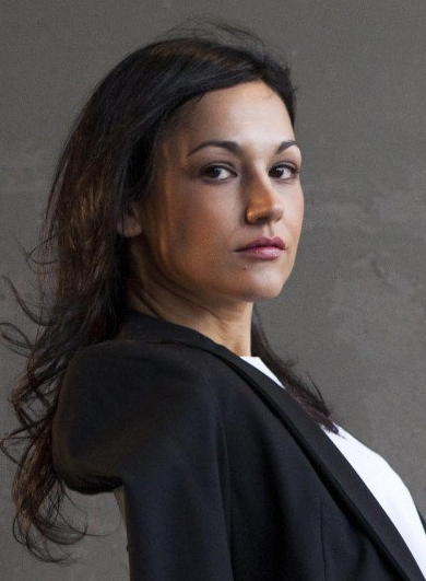 """Dyanis de Jesús - Dyanis is a creative strategy consultant with over fifteen years of experience. For the past five years Dyanis has been advocating for the cultural and creative industries as key contributors to economic development. In 2012 she completed her thesis, """"Designing Sustainability into Creative Economies"""", and co-founded the Creative Economy Initiative in her home country Puerto Rico. She is an author and a partner at Creatives Mean Business."""