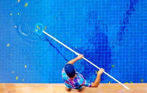 Swimming-Pool-Cleaning[1].jpg