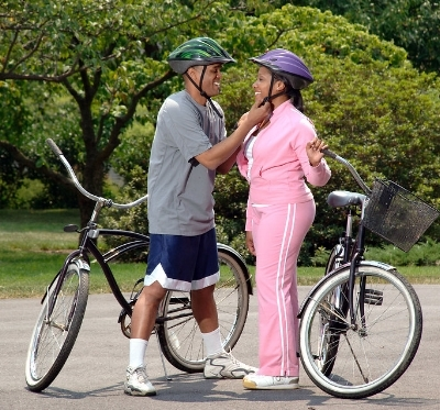 17049-an-african-american-couple-preparing-to-ride-bikes-pv.jpg