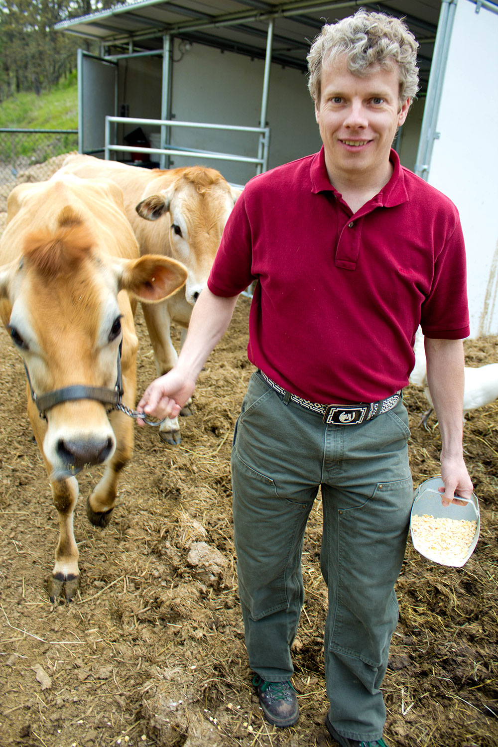 Mike-Omeg-Farmer-with-Cow.jpg