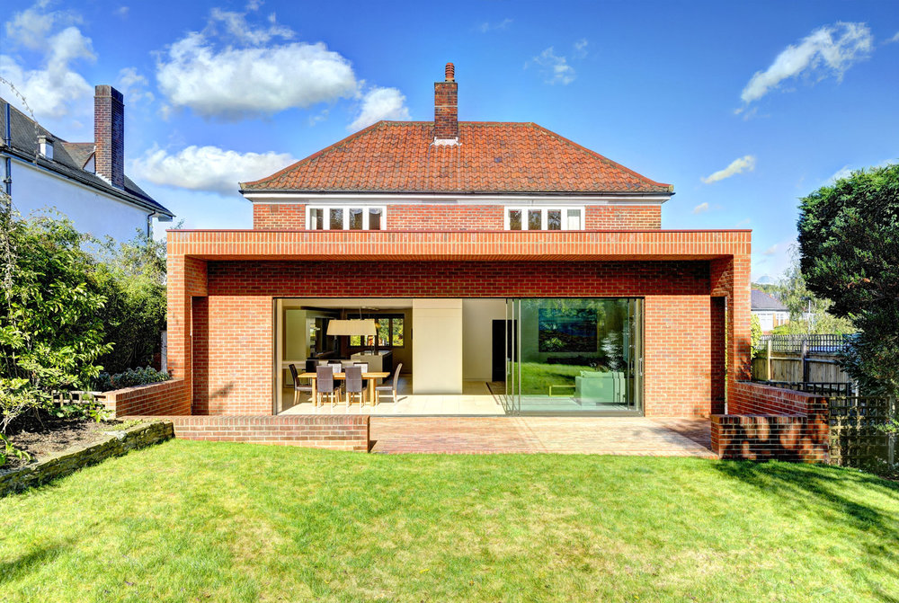 Muswell Hill House - London   This 1930s built detached house has been enlarged by about 60 sq.m at ground floor level and opened up to produce a very large open plan entertaining area.