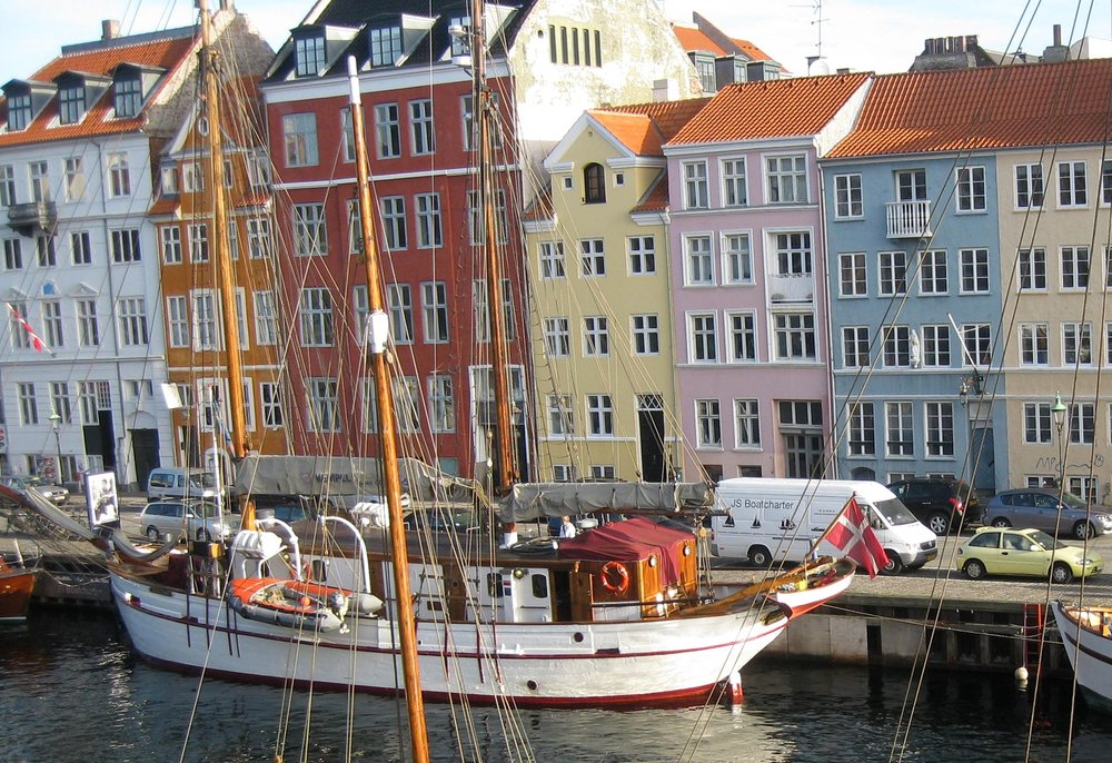 Photo of the old houses in Nyhavn where Hans Christian Andersen once lived. The colour of have a hearts graphics mirror those of the old houses.