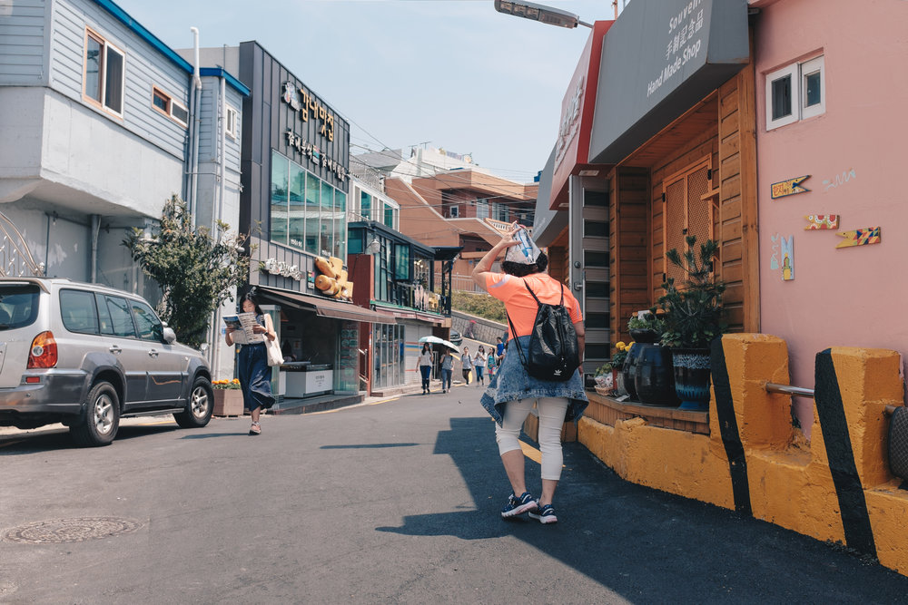 An interestingly dressed tourist exploring Gamcheon Cultural Village