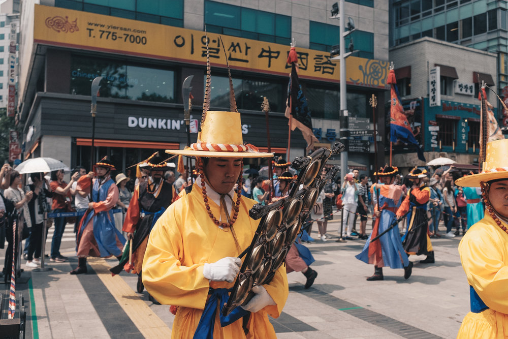 A musician playing the Ulla - a traditional Korean percussion instrument