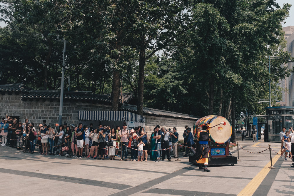 The beating of the Buk signifies the start of the Changing of the Guard ceremony - Deoksugung Palace