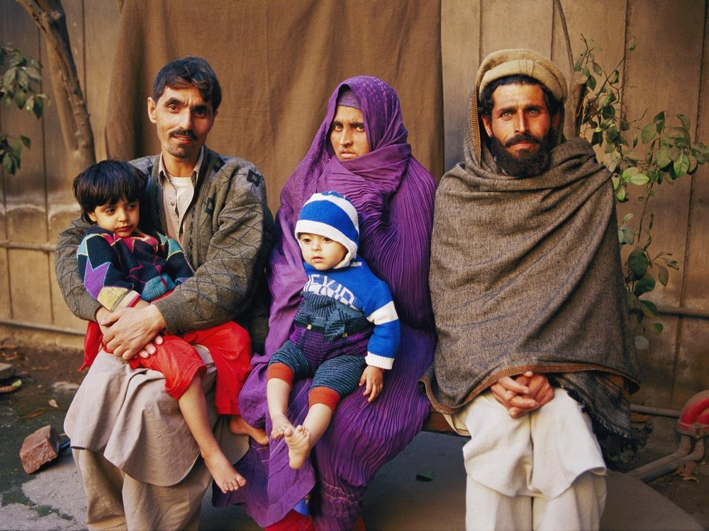 A photo of what the Afghan Girl looks like now - Sharbat Gula and her family,  photo from National Geographic