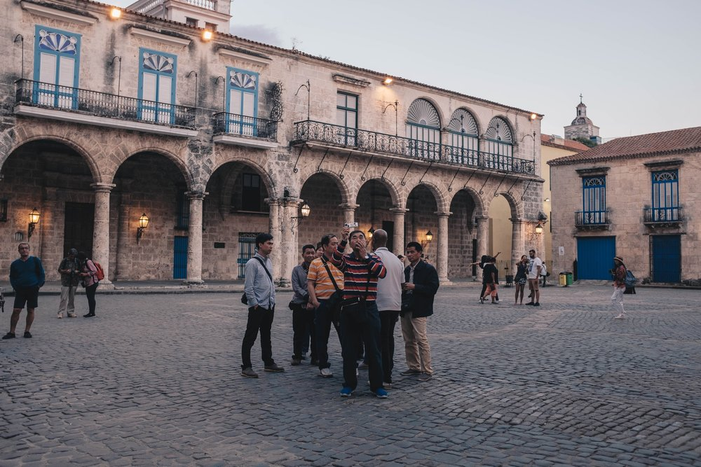 Chinese tourists exploring and documenting La Habana Vieja through their own lens