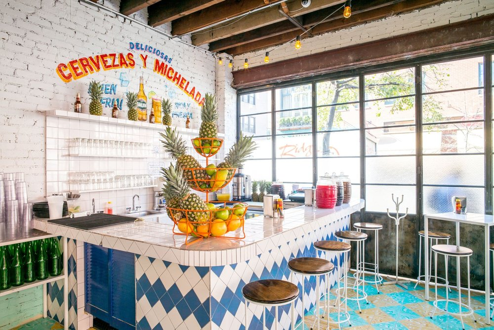 Tacombi is a taqueria that serves up excellent tacos in a wholly welcoming and well decor-ed interior,  photo from EATER