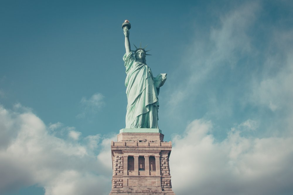 The Statue of Liberty stands proud as a veritable symbol of New York City, photo by  Anthony DELANOIX  on  Unsplash