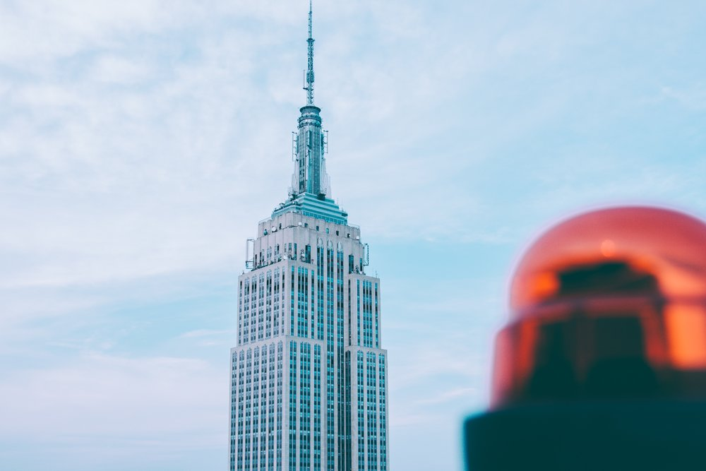 The Empire State Building incorporates setbacks (the building tapers the higher it stretches) in its design to conform to New York City's unique regulations on skyscraper construction, photo by  Dapo Oni  on  Unsplash