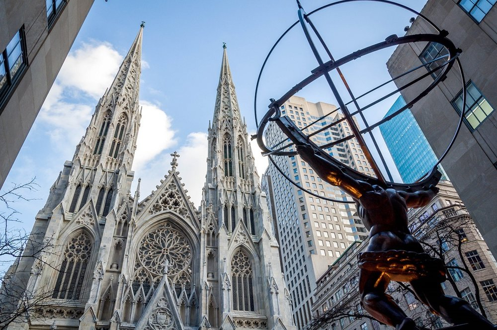 The infamous statue 'Atlas' adorns a side entrance to 30 Rock,  photo from Travel Addicts