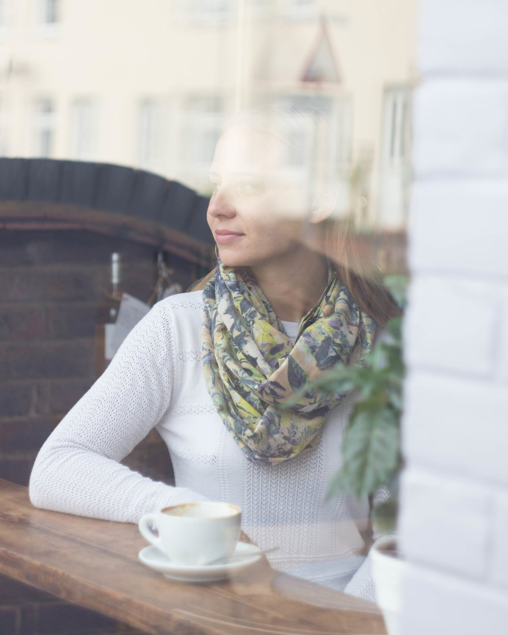 Linda drinking coffee at Coffee & Wine
