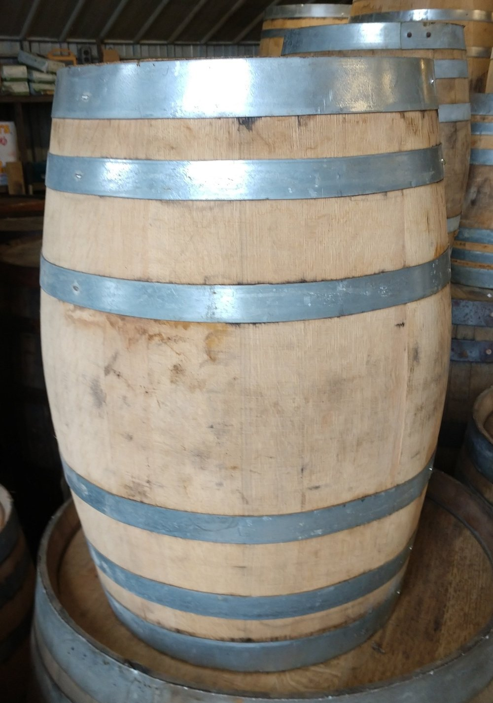 """Small Whiskey Barrel - These little beauties stand at 22"""" tall. They have many different uses. They can be used as stools, side tables, or just something set other decor items on top of.Rental is $20eaInterested in purchasing instead of renting? Follow this link to purchase now!"""