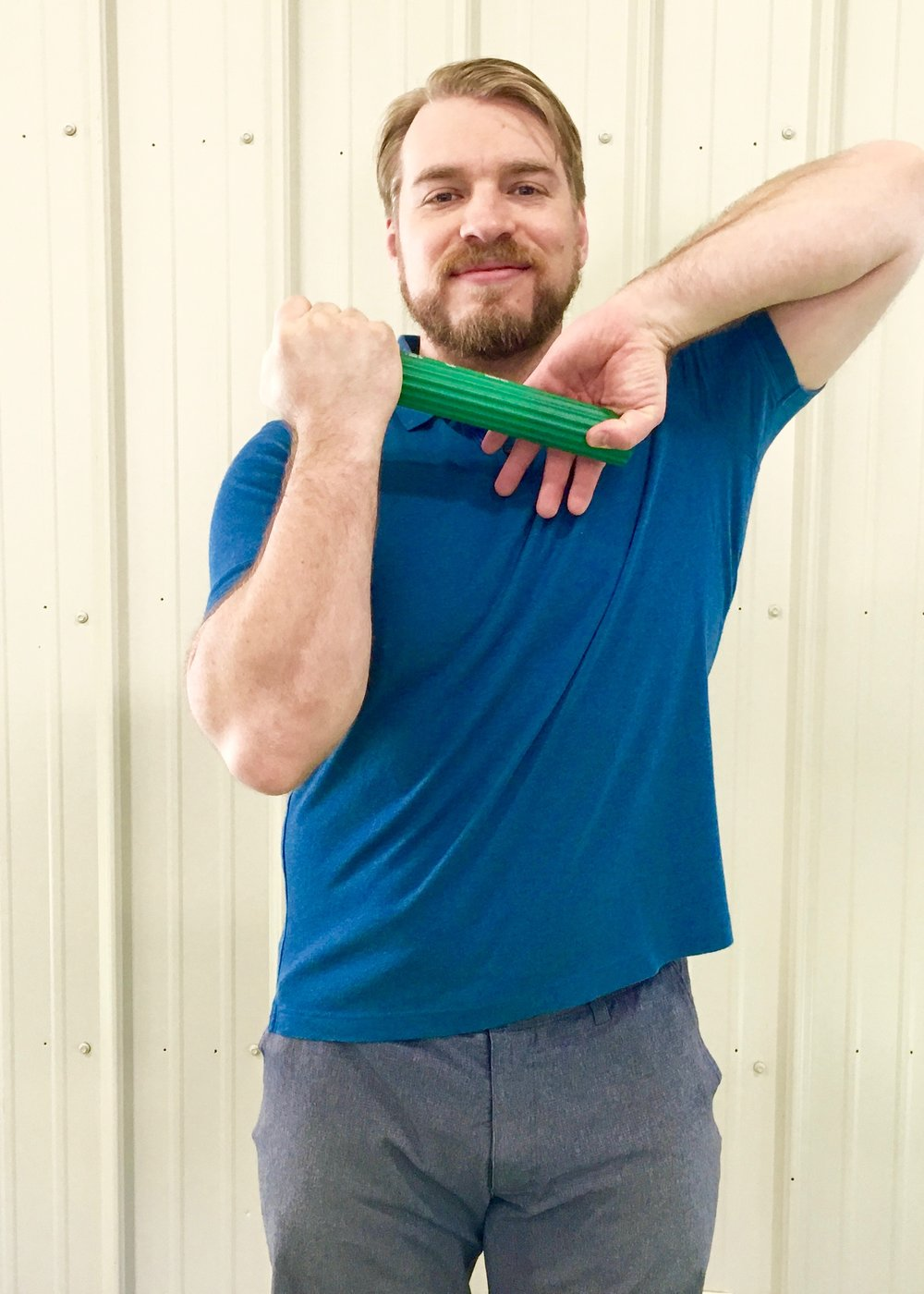 Golfer's Elbow 2 - Lift uninjured elbow high while grabbing bar, palm facing away.