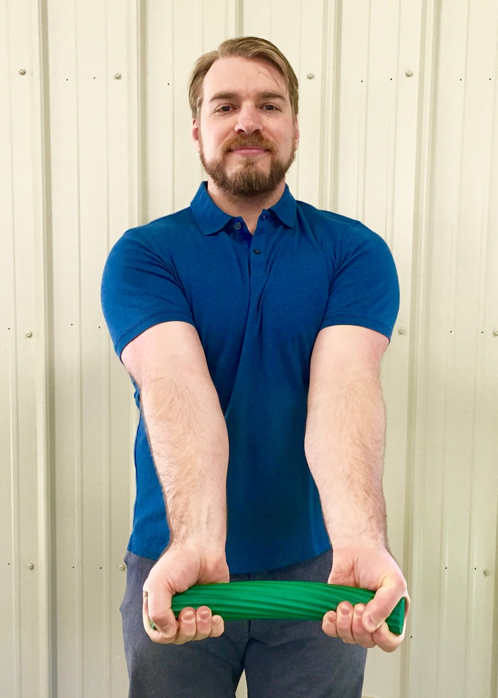 Golfer's Elbow 5 - Slowly allow the wrist of your injured arm to extend while squeezing the bar. Reset your grip for each rep.