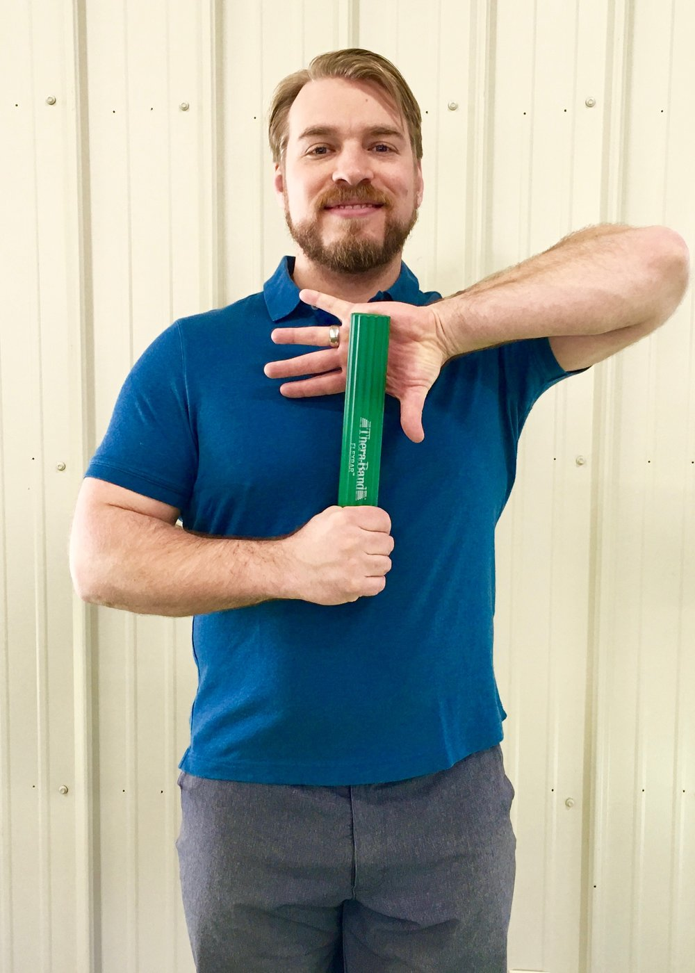 Tennis Elbow Exercise 2 - Lift uninjured elbow high while grabbing bar, palm facing away.