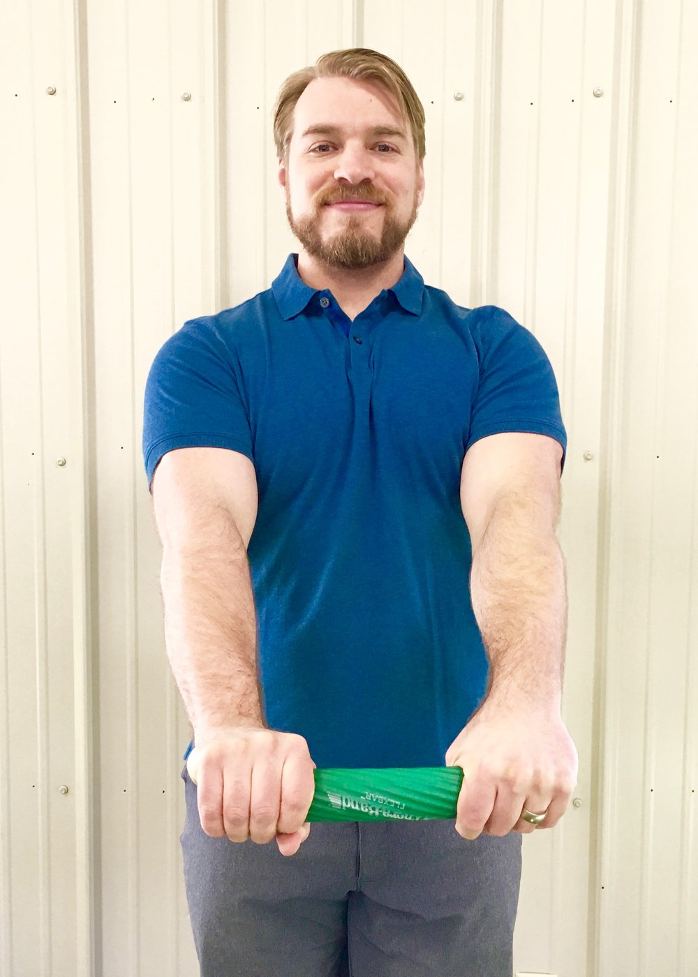 Tennis Elbow Exercise 4 - Straighten both arms while extending the wrist of the injured side.