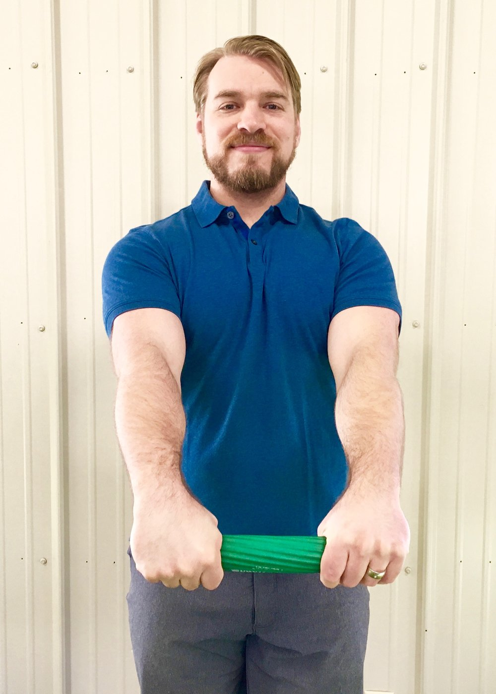 Tennis Elbow Exercise 5 - Slowly allow the wrist of your injured arm to flex while squeezing the bar. Reset your grip for each rep.