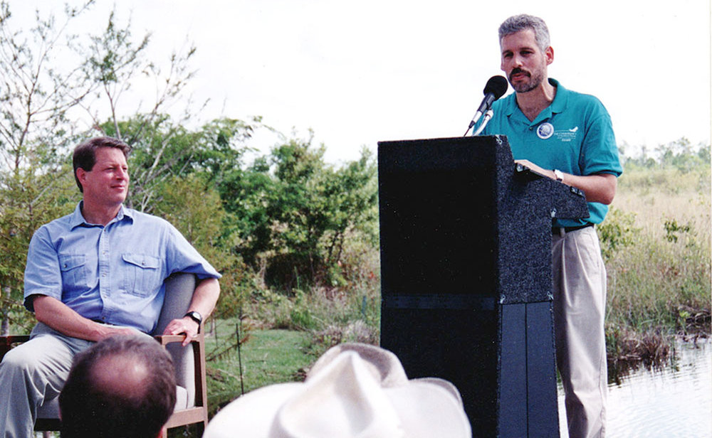 Vice President Al Gore (left) and Dr. David E. Guggenheim (right) in Everglades National Park on June 17, 1997 for the announcement of a $25 million federal grant to help Florida acquire 31,000 acres of private land in the Everglades. Photo credit: Michael Simonik