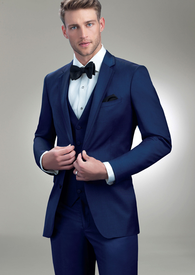 Allure Men Cobalt Brunswick - Luxury wool2 buttonNavyShown with coordinating accessories.Elegant super 130's wool. Trim fit featuring matching self fabric edging cut on the bias along the notch lapel and top collar. Two button front, side vented with besom trimmed flap pockets.