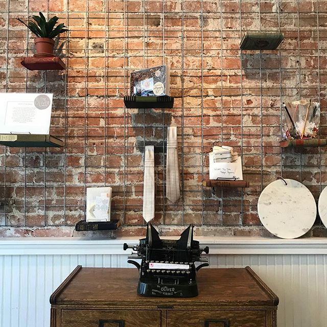 Old books + some wire = literal book shelves. I just *knew* we'd figure out how to use that beautiful brick wall without covering it all up! // #coloradobusiness #indiebookstore #smallbusiness #bookish #bookshelves #bookworm #shelfie