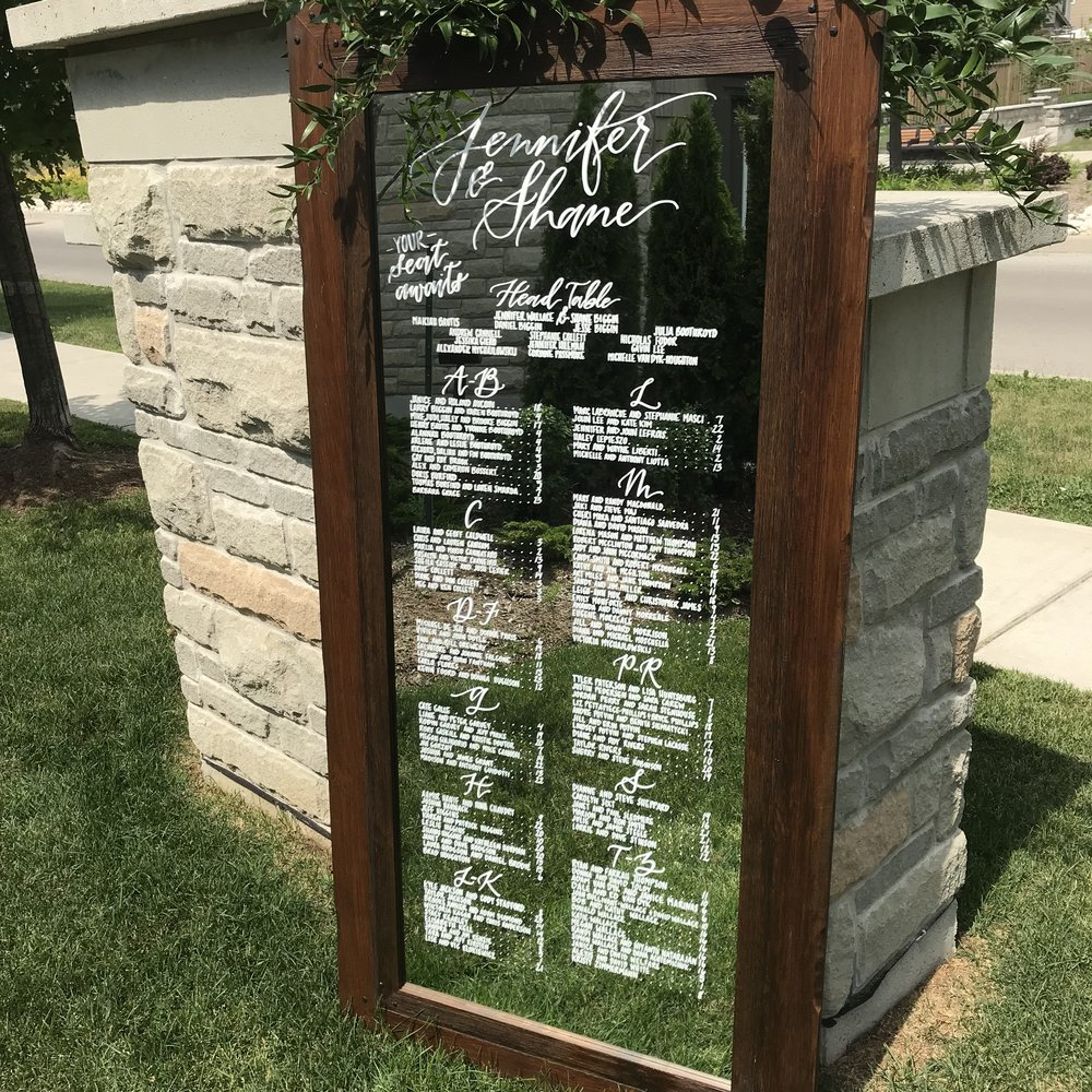 Wedding Mirror Seating Chart hand lettered by Crystalline Script in Guelph Ontario