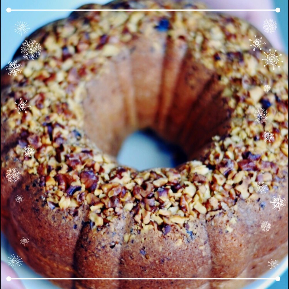 """Rum Cakes $38 Sure to be a crowd pleaser, our 9"""" Rum cakes are fresh baked using the finest Trinidadian Rum, and lots of butter. These decadent desserts are perfect for holiday tables! Our Rum cakes come plain (with Pecans) or Coconut."""