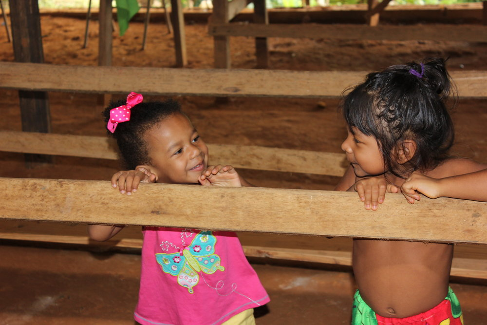 Embera child and tourist