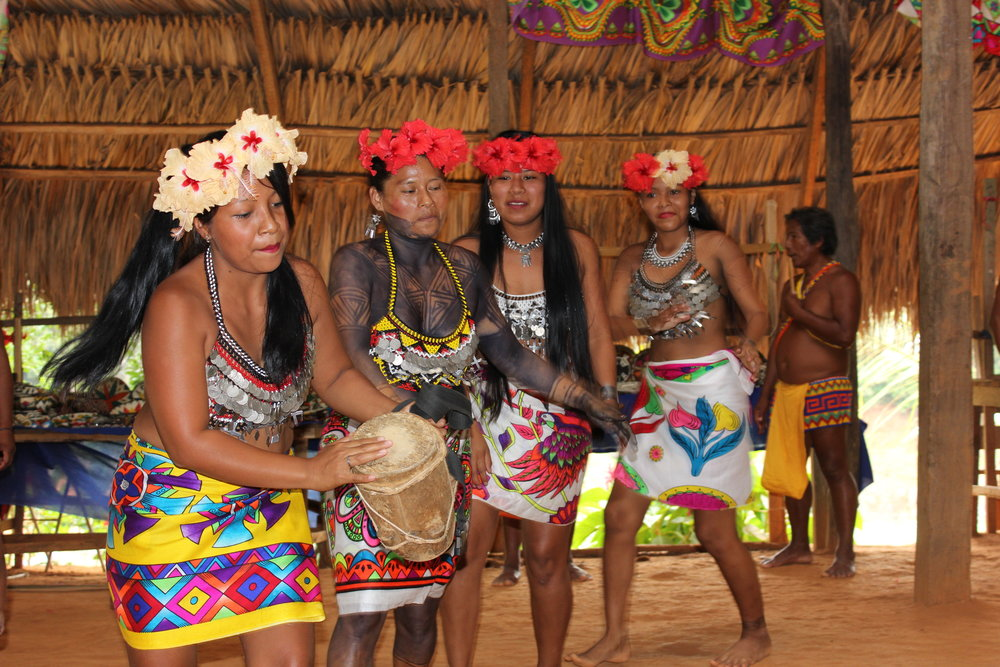 Embera and tourists dancing